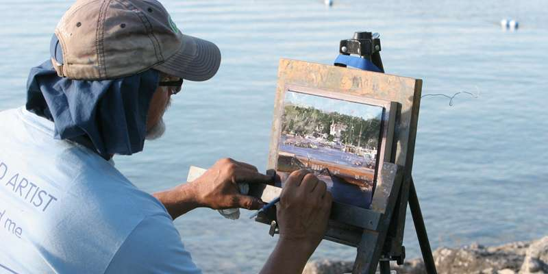 Festival artist Doug Braithwaite, of Utah, puts the finishing touches on his marine landscape.