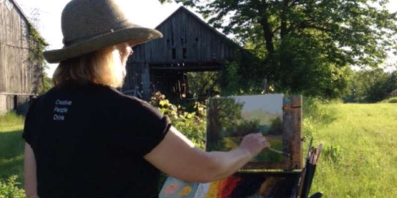 As the sun sets, artist Pamela Ruschman paints rural Ozaukee County.