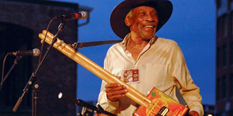 Mac Arnold with his signature Gasoline Can Guitar