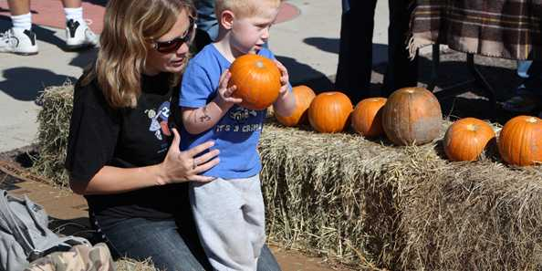Children can try to knock down colorfully decorated pins in Pumpkin Bowling!