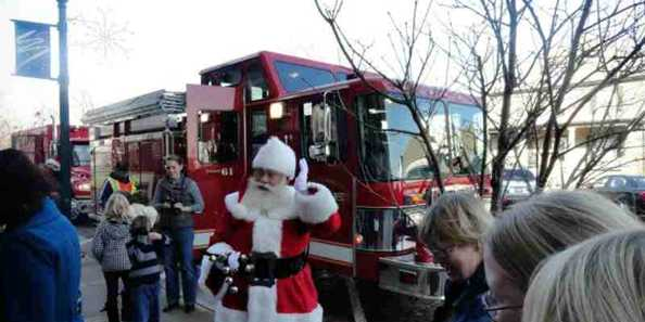 During Evansville's Olde Fashioned Christmas, Santa makes a surprise visit.  He arrives by local firetruck to the delight of kids of all ages.