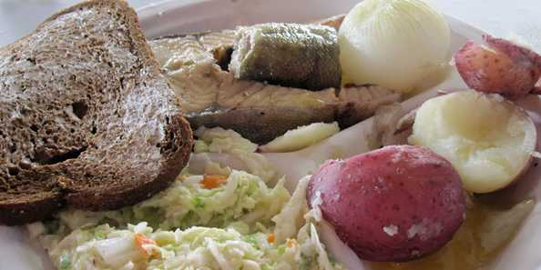 Delicious lake trout, potatoes & onions, cole slaw, & rye bread & butter