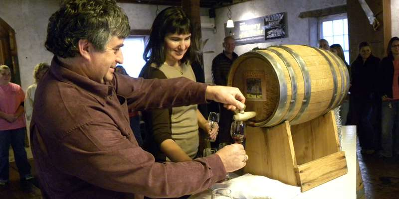 Wollersheim's Winemaker Philippe Coquard taps a barrel of Ruby Nouveau