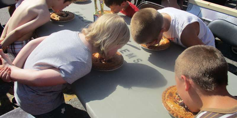 Pie in your face - Kids having a blast filling their stomachs and making a mess!