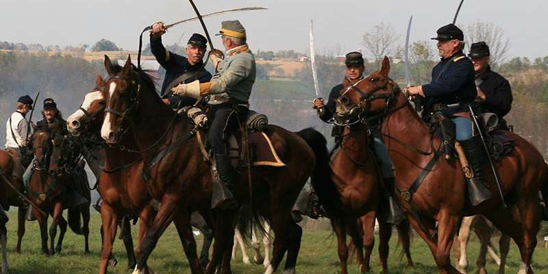 Confederate and Union cavalrymen in battle