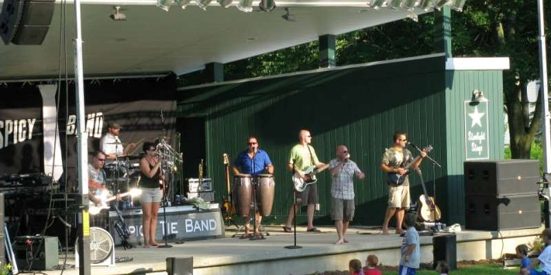 The Spicy Tie Band performs at Deacon Mills Park