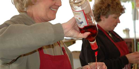 Pouring wine at the Wet Whistle Wine Fest