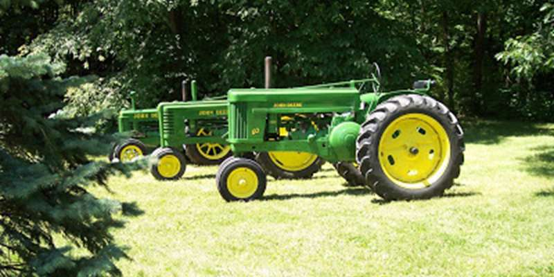 A row of John Deere Tractors