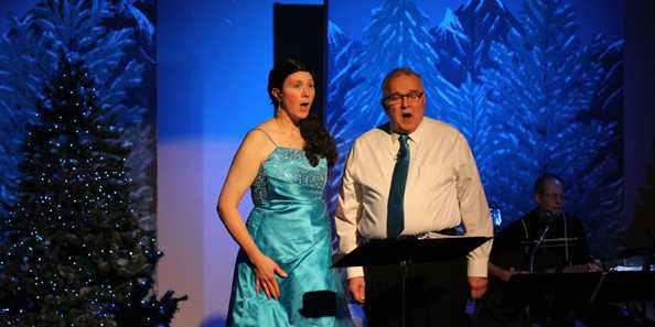 Kerrylynn Kraemer-Mahlendorf and Tom Clegg singing in Celtic Christmas 2014