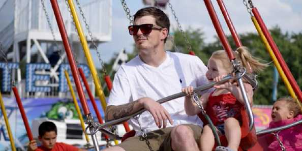 Jake Poling and his daughter Braylee Poling, 2, enjoy the assortment of rides available for all ages at Riverfest.