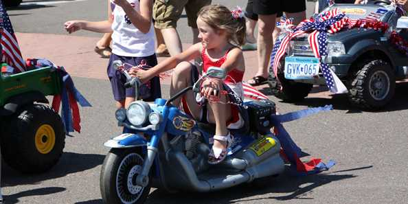 The Kiddie Parade is followed by the Grand Parade on Main Street.