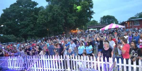 View of the crowd gathering during Sunday evening's performance by Separate Ways at Riverfest