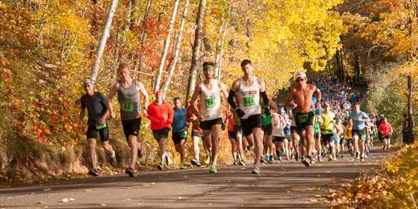 Runners enjoy the cool crisp autumn air and fall colors as they run along the trail during the 2013 CenturyLink WhistleStop Marathon.