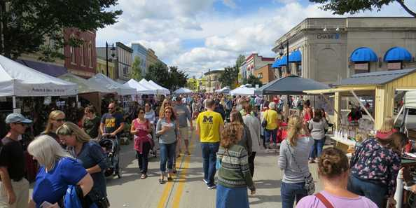Vendors line downtown Oconomowoc's main street for Fall Fest shopping.