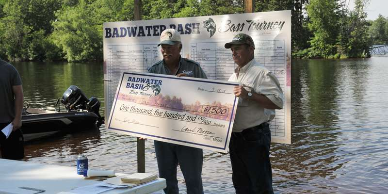 Winners of the BIG CHECK for largest bass