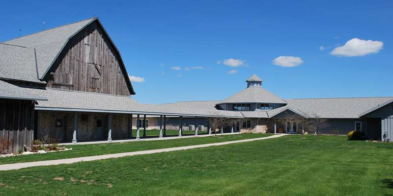 Birch Creek campus. Concert Barn on left, and rehearsal hall on right.