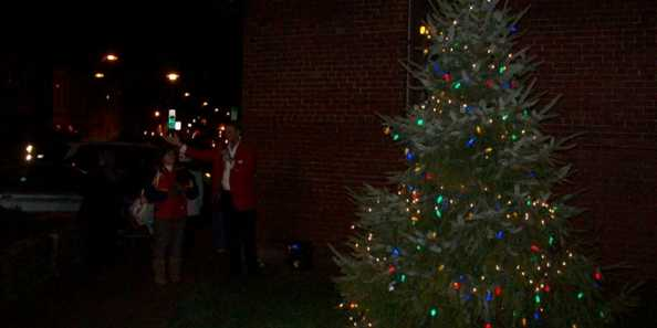 The Mayor of Beaver Dam lights the tree at the Chamber of Commerce to begin the holiday celebrations