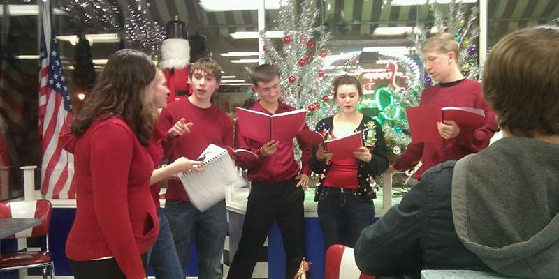 Carolers at Scoop DeVille