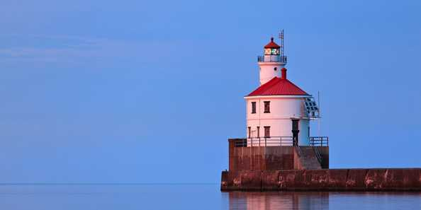 Superior Entry Lighthouse bathed in pink