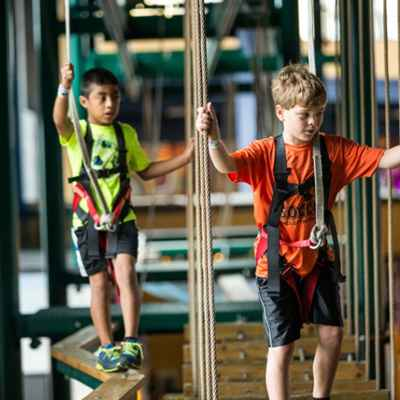 Young boys on ropes course