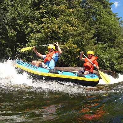 Two guys hitting some rapids