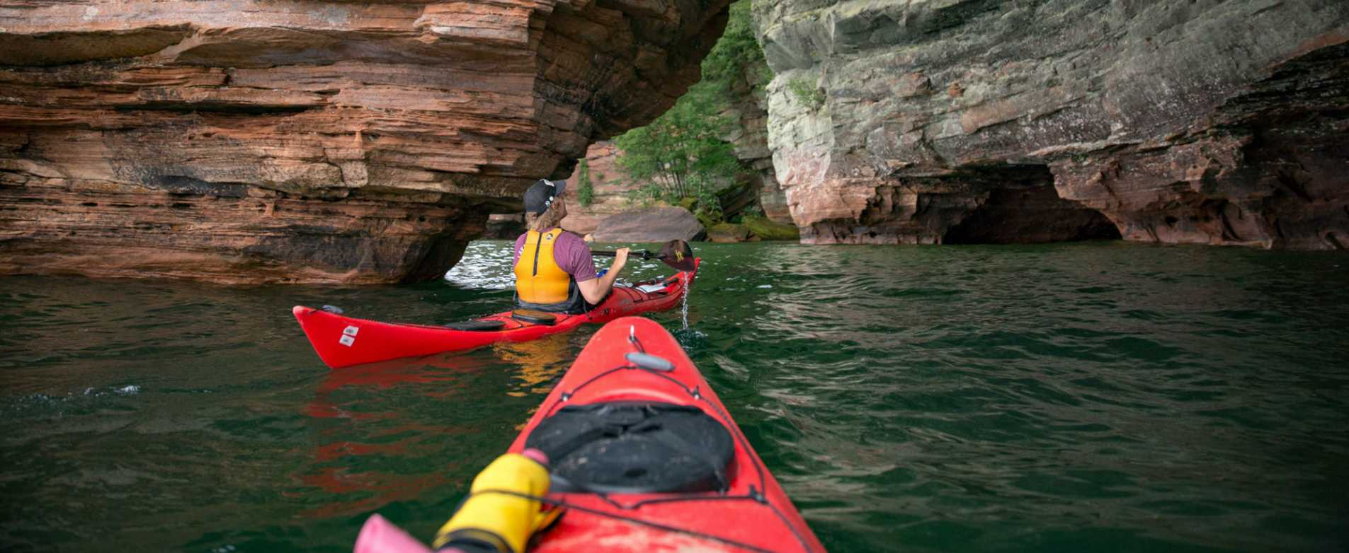 Kayaker Looking UP at Rock Formation at Apostle Islands