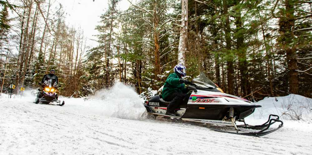 36 Snowmobile Rider on Trail in Eagle River