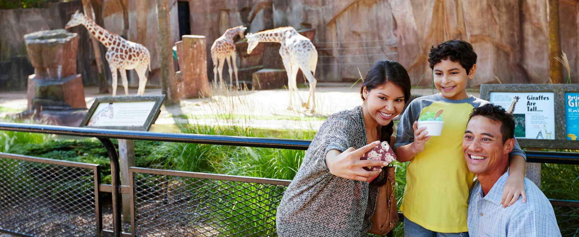 Family Taking Selfie by Giraffe Exhibit at Milwaukee County Zoo