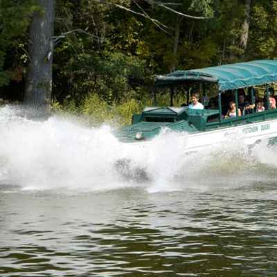 Duck boat splashing into the water