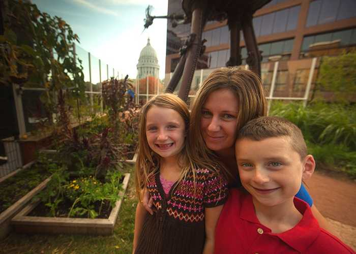 Mom and children on Madison Children's Museum rooftop garden