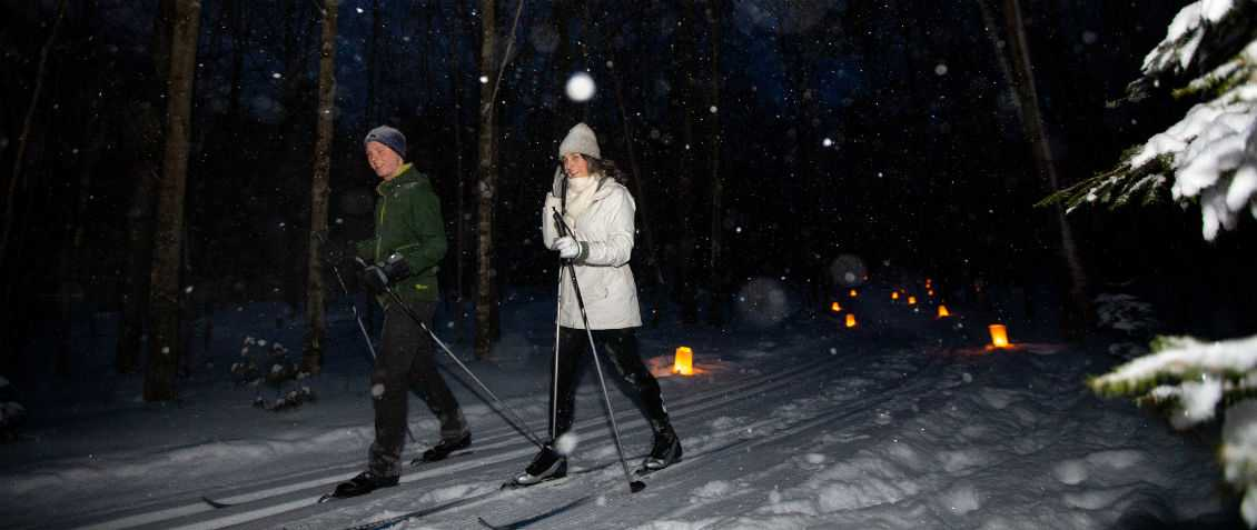 Cross-Country Skiing on Candlelit Trail at Fish Creek Winter Festival