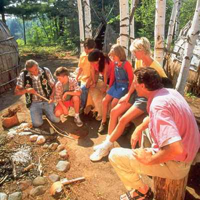 Native American teaching family outside