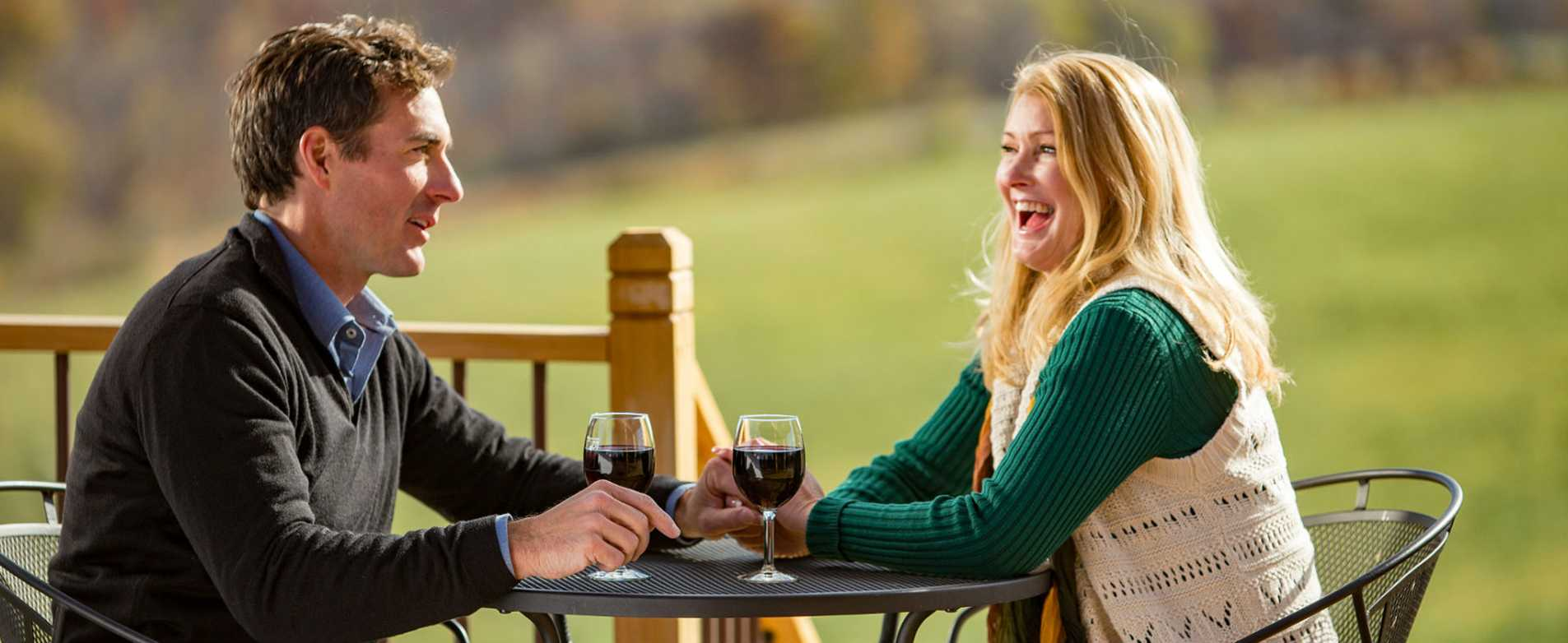 Couple drinking wine on patio at Vernon Vineyards