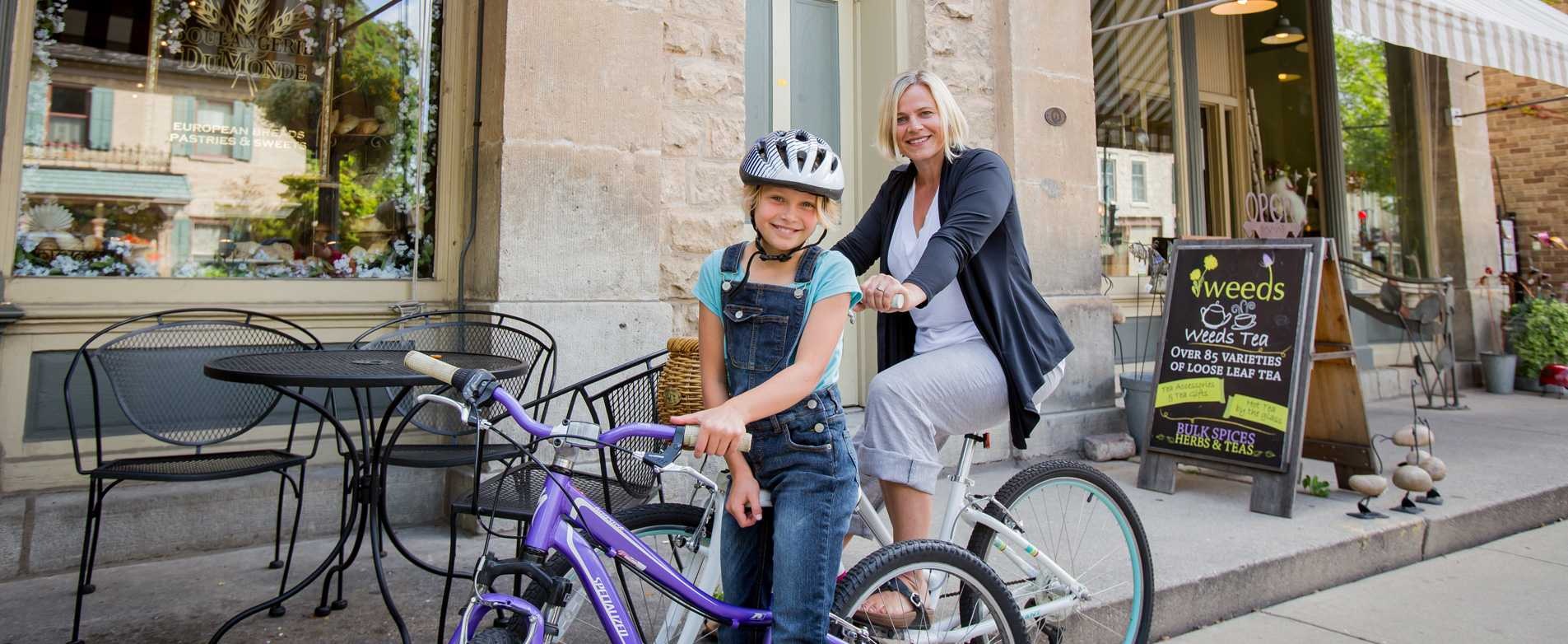 Mom-and-Daughter-on-Bikes-Downtown-Cedarburg
