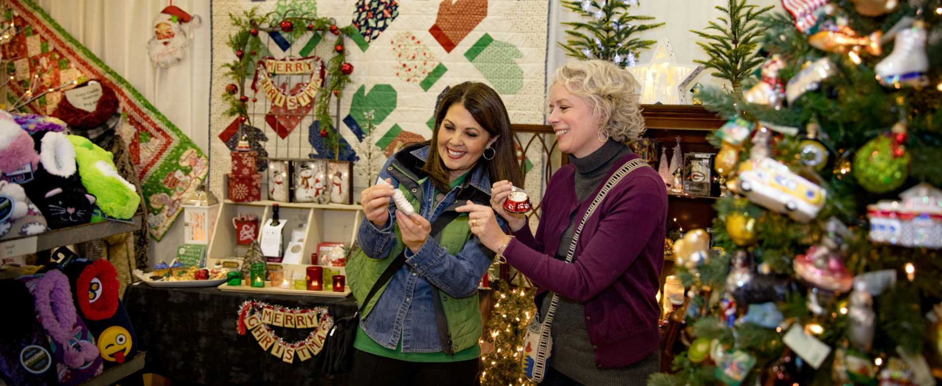 Women Looking at Ornaments at La Crosse Holiday Fair Entertainment and Attractions Header