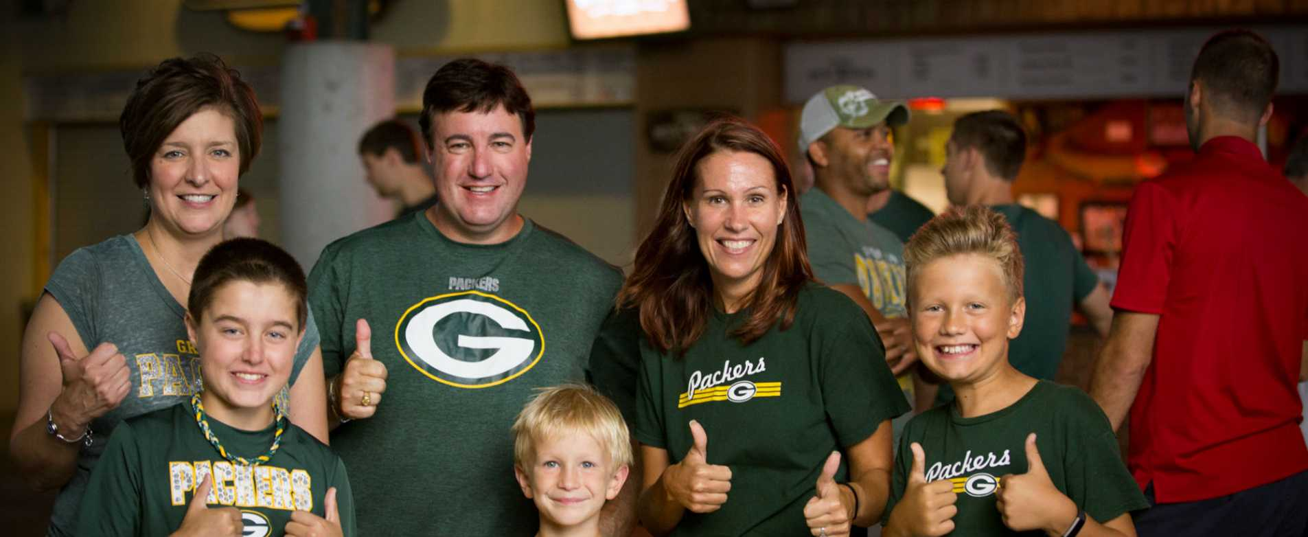 Packers Fans Giving Thumbs Up in Lambeau Field Atrium