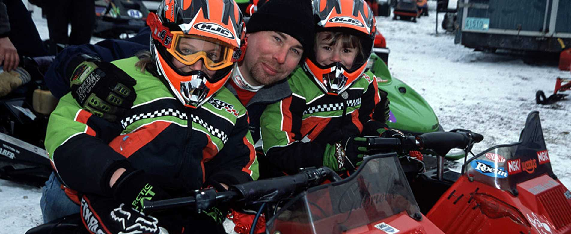 Kids on snowmobiles