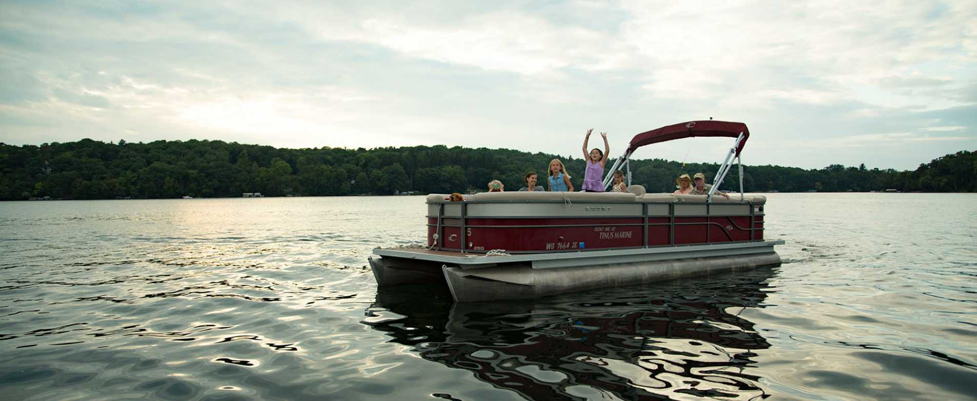 Family on Pontoon Boat on Pine Lake
