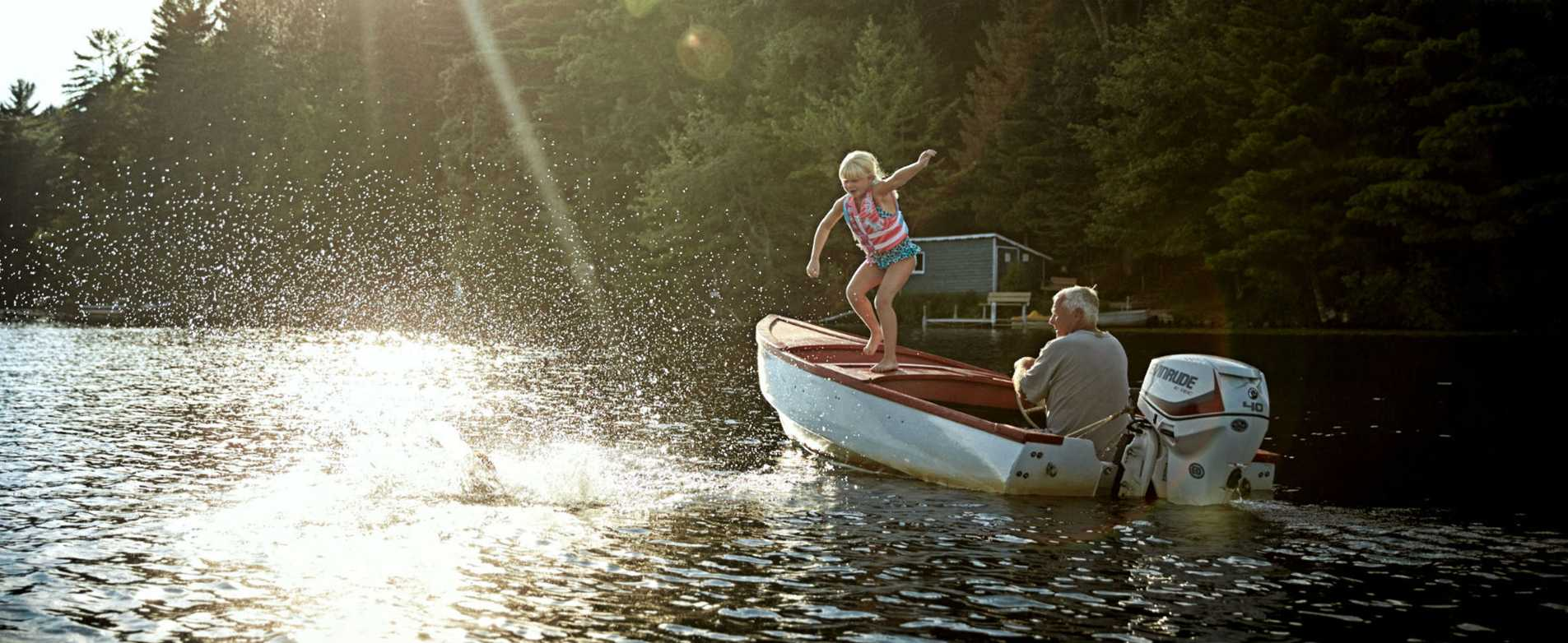 Girl Jumping off Boat into Lake