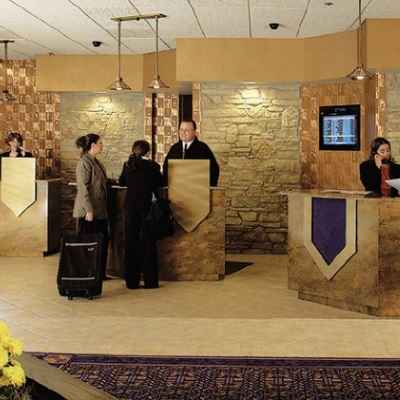 Guests checking into Radisson Hotel & Conference