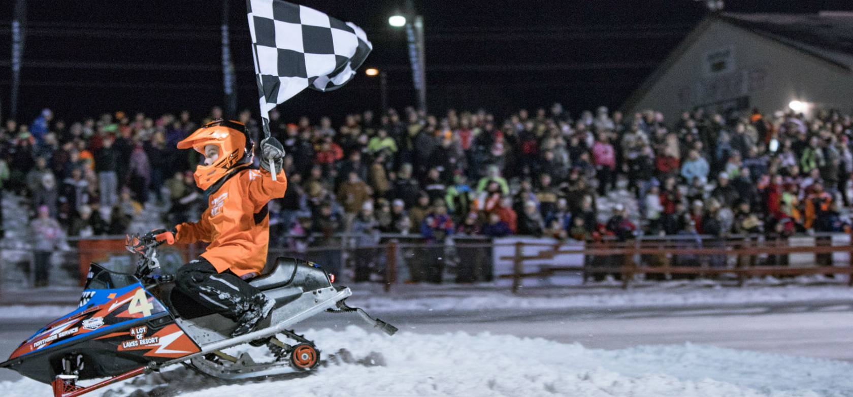148 Snowmobile Riders at Night at Eagle River Championship Derby