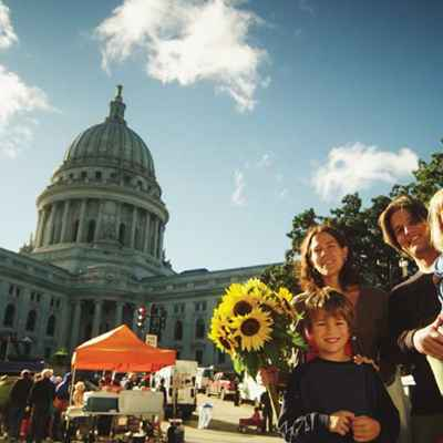 family at farmers market with capitol