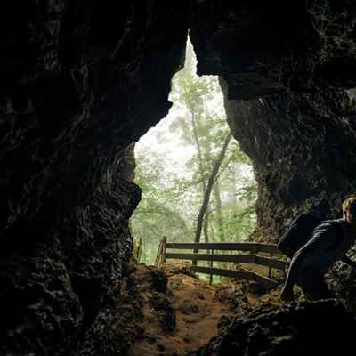 man hiking cave at waylusing state park