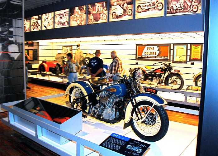 Visitors look at Harley-Davidson motorcycles