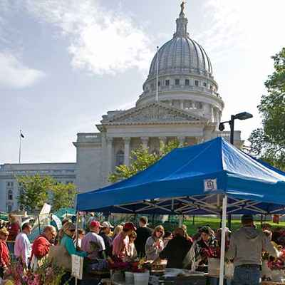 Packed farmers' market in the shadow of the Capitol