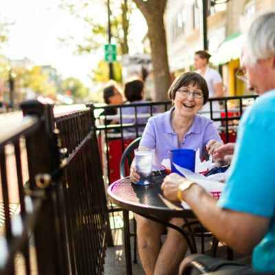 couple enjoying meal on sidewalk cafe