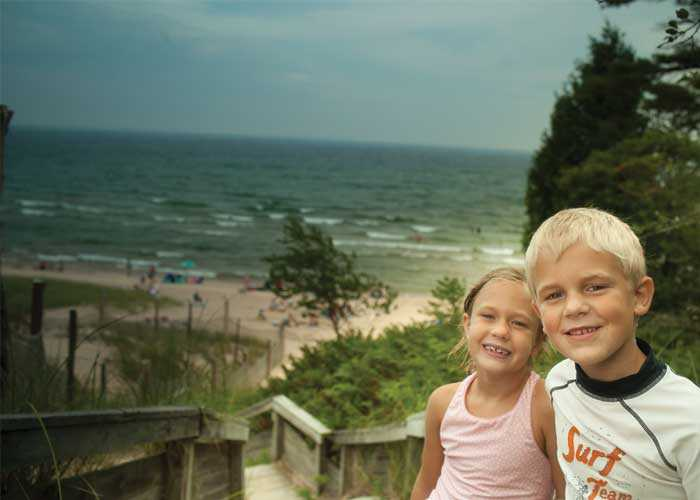 children at whitefish dunes beach