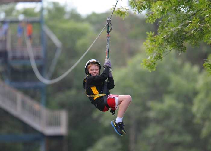 young boy on zipline