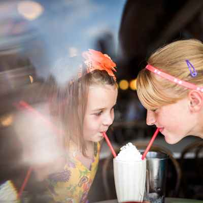 Young girls drinking a shake