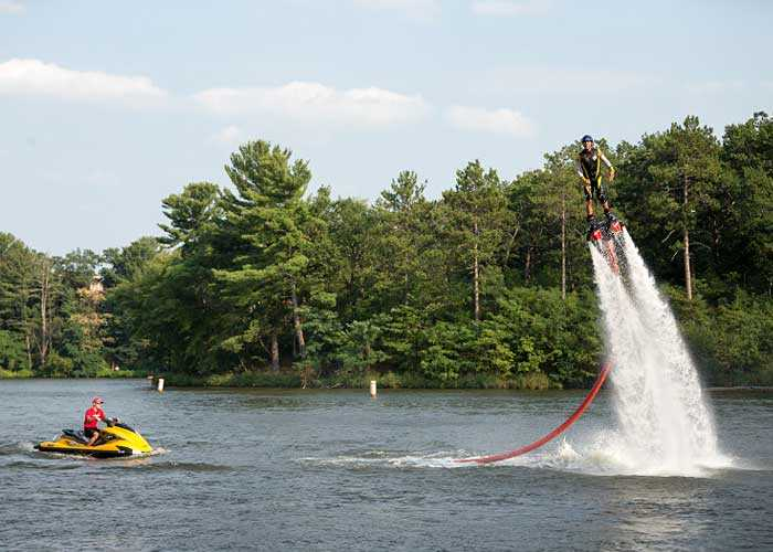 Man FlyBoarding above the lake water